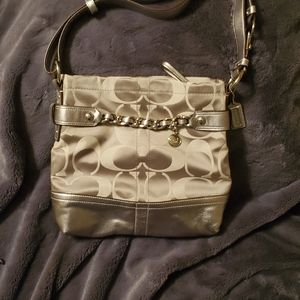 Coach signature gold handbag with chain accent